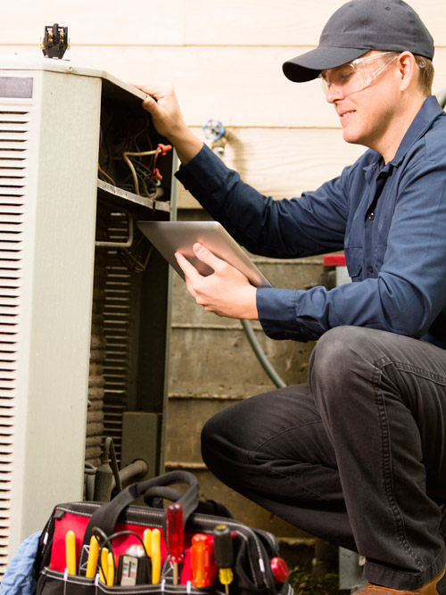 Repairman Fixing Residential A/C Unit