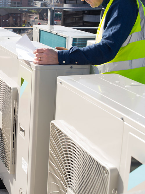 Repairman Servicing Commercial HVAC System