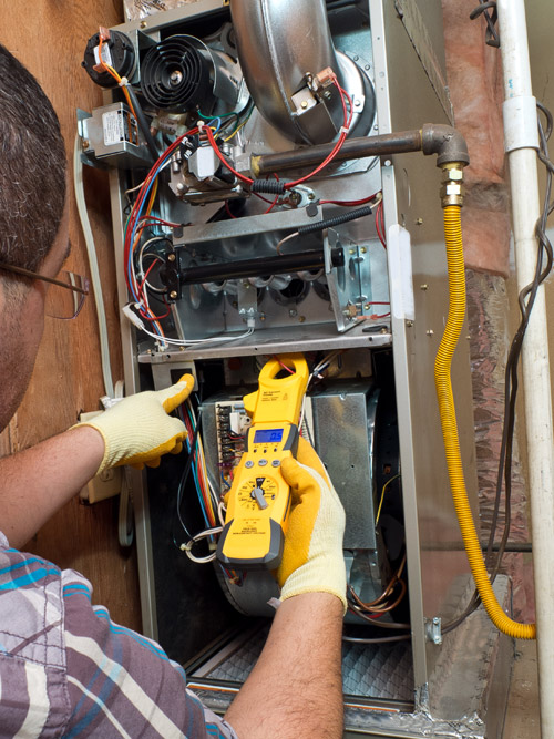 Man Fixing a Gas Furnace